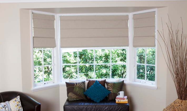 How do you clean fabric roman shades?