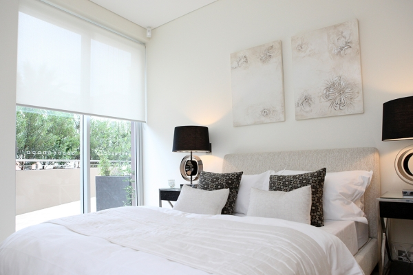 Block out the summer heat with roller blinds